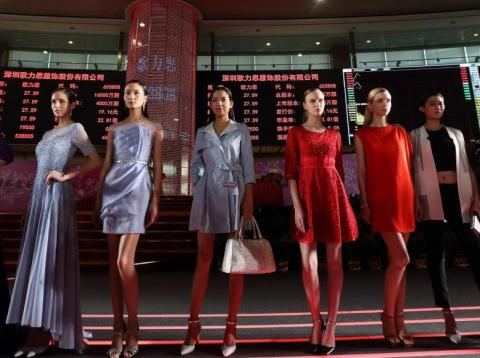 Models showcase Ellassay on the trading floor of the Shanghai Stock Exchange April 22, 2015 in Shanghai, China.
