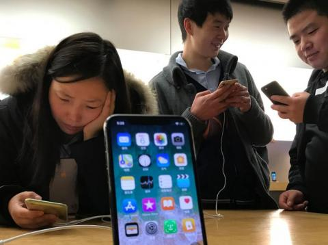 Trump warns that iPhones may get slapped with tariffs.