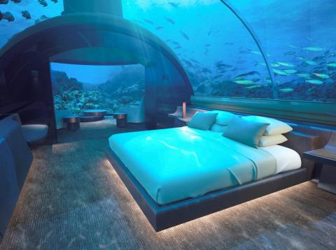 The undersea master bedroom, which fits a king-size bed, offers 180-degree views of sea life for an otherworldly experience. You can even wash your hands and shower while watching the fish swim by.