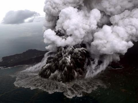 This aerial picture taken on December 23, 2018 by Bisnis Indonesia shows the Anak (Child) Krakatoa volcano erupting in the Sunda Straits off the coast of southern Sumatra and the western tip of Java. - The death toll from the