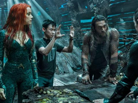 "(L-R) Amber Heard, director James Wan, and Jason Momoa on the set of ""Aquaman."""