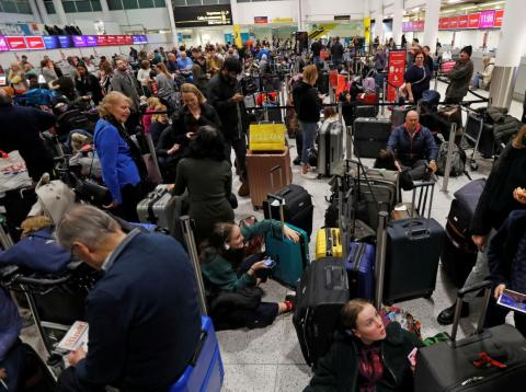 Passengers wait in Gatwick's South Terminal on Thursday.