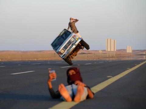 This Saudi man looks like he's balancing a car on his head.