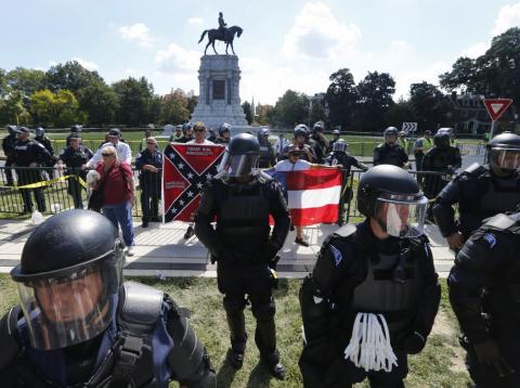 State Police keep a handful of Confederate protesters separated from counter demonstrators in front of the statue of Confederate General Robert E. Lee on Monument Avenue in Richmond, Virginia, Saturday, Sept. 16, 2017.