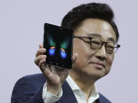 Samsung's DJ Koh shows off the Galaxy Fold.