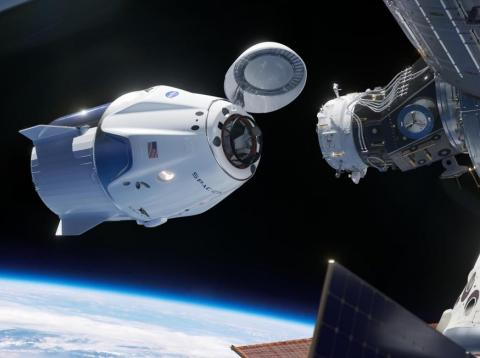 An illustration of SpaceX's Crew Dragon vehicle, a spaceship designed to fly NASA astronauts, docking with the International Space Station.