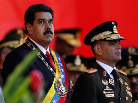Venezuelan President Nicolas Maduro at a military parade to celebrate the 195th anniversary of the Battle of Carabobo, next to Venezuelan Defense Minister Vladimir Padrino Lopez, in Caracas, June 24, 2016.