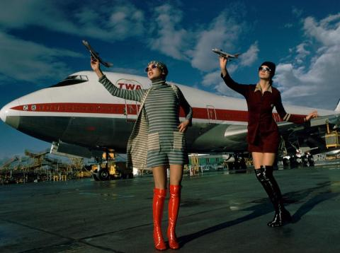 Models pose in front of a TWA Boeing 747 jumbo jet.