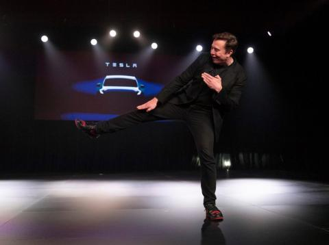 Tesla CEO Elon Musk shows off his sneakers before introducing Tesla's new Model Y in March 2019.