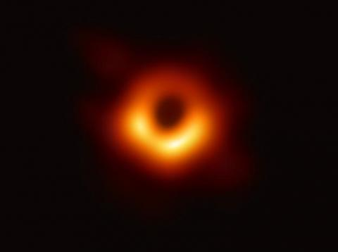 Scientists have obtained the first image of a black hole, using Event Horizon Telescope observations of the center of the galaxy M87. The image shows a bright ring formed as light bends in the intense gravity around a black hole