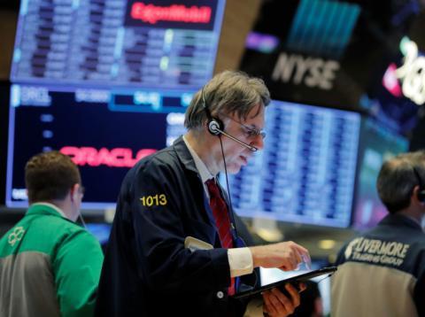 Trader operando en Wall Street