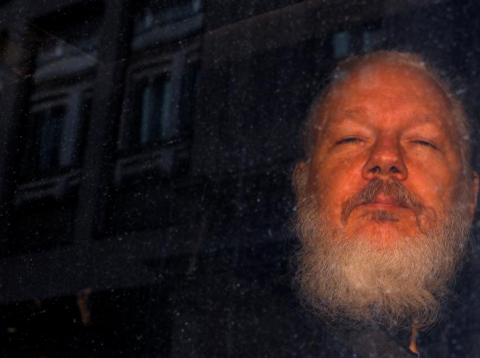 WikiLeaks founder Julian Assange is seen as he leaves a police station in London on April 11, 2019.