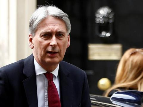Britain's Chancellor of the Exchequer Philip Hammond is seen outside Downing Street in London