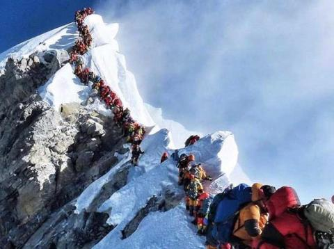 "Climbers waiting in the ""death zone"" to summit Mount Everest."