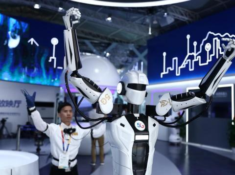 An intelligent robot copies the movement of a visitor wearing sensor suit during the opening of 2019 Beijing International Horticultural Exhibition.