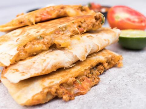 Quesadillas made with canned beans, store-bought tortillas, deli meat, and shredded cheese are considered processed food.