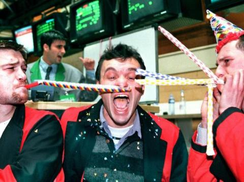 Traders celebrating a record-setting day of shorting volatility.