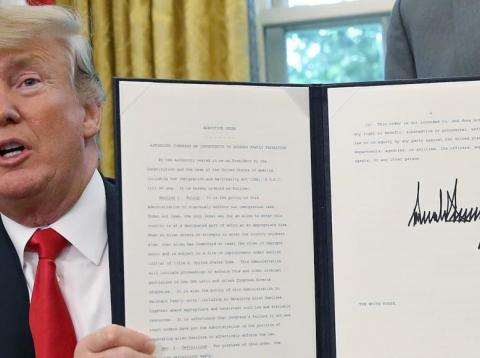 President Donald Trump displays an executive order in Washington DC, June 20, 2018.