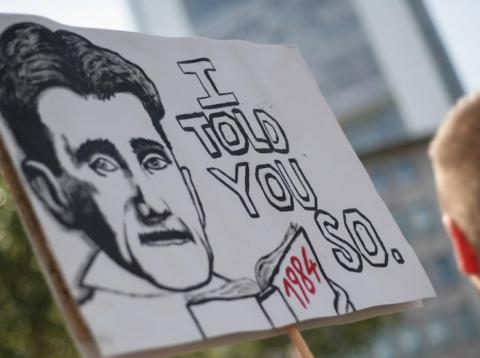 Protesters carrying a placard bearing George Orwell's face show their solidarity with whistle-blower Edward Snowden and demand protection and asylum, on July 27, 2013.