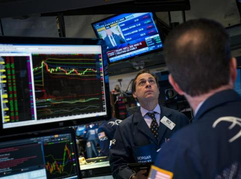 Traders watch President Donald Trump's announcement on steel and aluminum tariffs on the floor of the New York Stock Exchange (NYSE) ahead of the closing bell, March 8, 2018 in New York City.