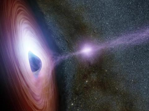 An artist's concept of a supermassive black hole surrounded by a swirling disk of material falling onto it.