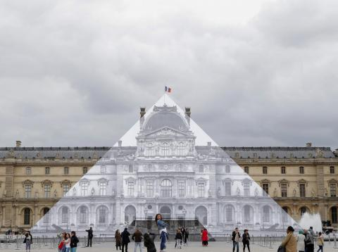 One of JR's most well-known projects was transforming the Louvre in Paris into a giant optical illusion.