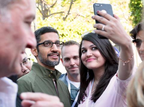 Google CEO Sundar Pichai talks with reporters at the 2018 I/O developer conference.