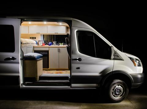 This custom tiny home on wheels was made from a Ford Transit van