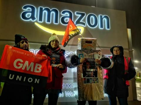 Union members protest outside an Amazon warehouse in the UK.
