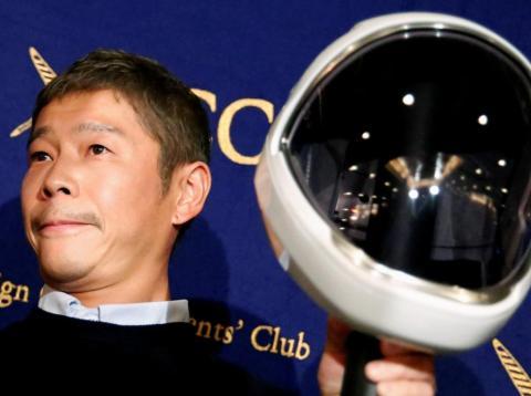 Yusaku Maezawa at a news conference in Tokyo.