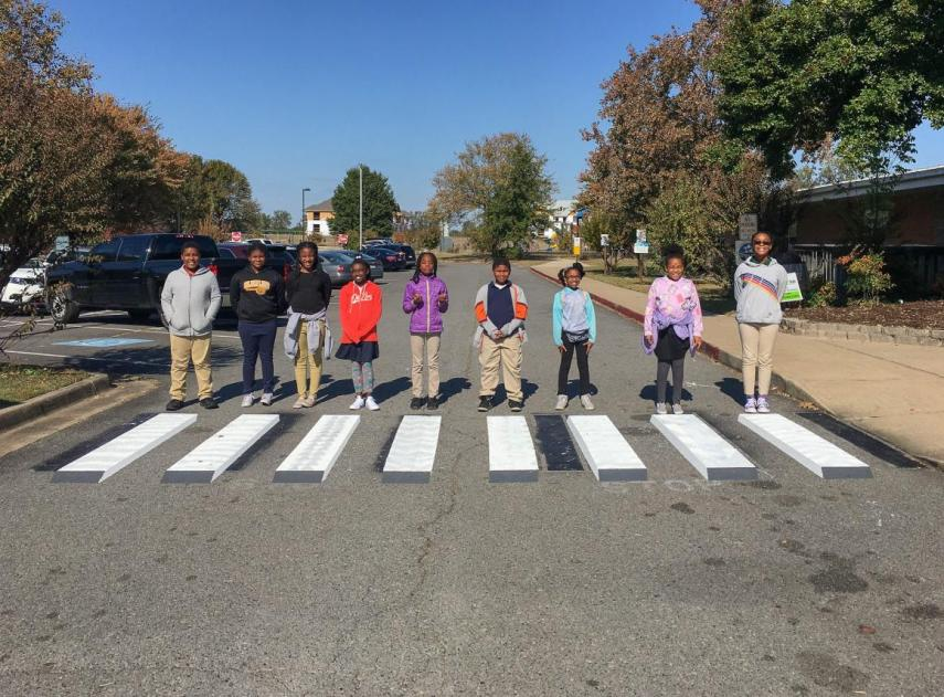 Elementary-school-class-little-rock-arkansas-painted-three-dimensional-crosswalks-front-their-school-trick-cars-slowing-down