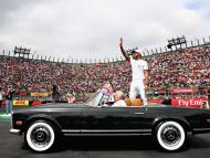 Lewis Hamilton in a vintage Merc.