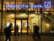 People walk past a branch of Deutsche Bank on February 9, 2016 in Berlin, Germany.