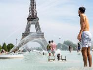 Tourists and Parisians cooling off in the water of the Trocadero fountain at the foot of the Eiffel Tower on Monday.