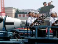 """Military vehicles carry missiles with characters reading """"Pukkuksong"""" during a military parade in Pyongyang."""