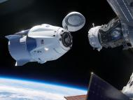 An artist's illustration shows the SpaceX Crew Dragon spacecraft docking to the International Space Station.