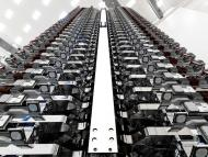 The first batch of 60 high-speed Starlink internet satellites, each weighing about 500 pounds, flat-packed into a stack before their launch aboard a Falcon 9 rocket on May 23, 2019.