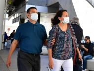 People wear face masks at Los Angeles International Airport (LAX) in Los Angeles, California on March 2, 2020.