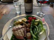 A standard dinner at David Harper's house: a tuna nicoise salad (hold the potatoes) served with a glass of red wine.