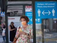 A woman wears a face mask as she waits at a bus stop on June 26, 2020 in Stockholm, Sweden. Stina St Jernkvist/TT News Agency/AFP via Getty Images