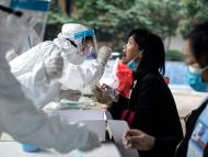 A medical worker takes a swab from a resident for the novel coronavirus test during community on May 15, 2020 in Wuhan, Hubei, China. Getty Images