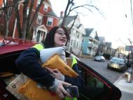 An Amazon Flex driver delivers packages in Cambridge, Mass., on Dec. 18, 2018. Pat Greenhouse/The Boston Globe via Getty Images
