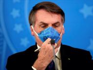 Brazil's President Jair Bolsonaro adjusts his protective face mask at a press statement during the coronavirus disease (COVID-19) outbreak in Brasilia, Brazil, March 20, 2020. Picture taken March 20, 2020. Ueslei Marcelino/Reuters
