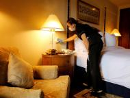 A Four Seasons Sultanahmet Hotel staff member disinfects a room in Istanbul, Turkey, on May 21, 2020. REUTERS/Umit Bektas