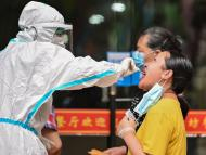 A medical worker takes a swab sample from a man to be tested for the COVID-19 coronavirus next to a street in Wuhan, in Chinas central Hubei province on May 16, 2020. HECTOR RETAMAL/AFP via Getty Images