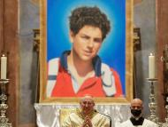 An image of 15-year-old Carlo Acutis, an Italian boy who died in 2006 of leukemia, is seen during his beatification ceremony celebrated by Cardinal Agostino Vallini, center, in the St. Francis Basilica, in Assisi, Italy, Saturday, Oct. 10, 2020. (AP Photo