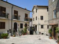 A small, empty street in Maenza, a medieval village in the Lazio region. Blue skies.
