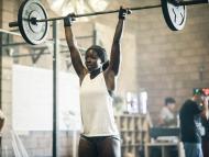 woman barbell shoulder press