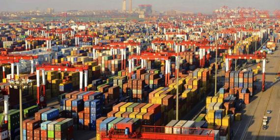 Shipping containers are seen piled up at a port in Qingdao, Shandong province December 10, 2013.