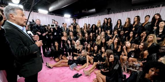 Ed Razek speaks to the 2018 Victoria's Secret runway models backstage during the 2018 Victoria's Secret Fashion Show at Pier 94 on November 8, 2018 in New York City.